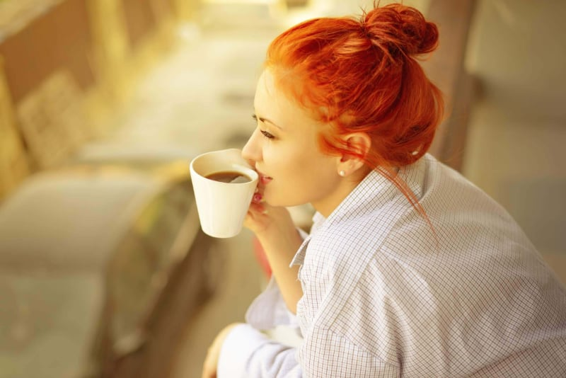 woman drinking coffee cause of teeth stains